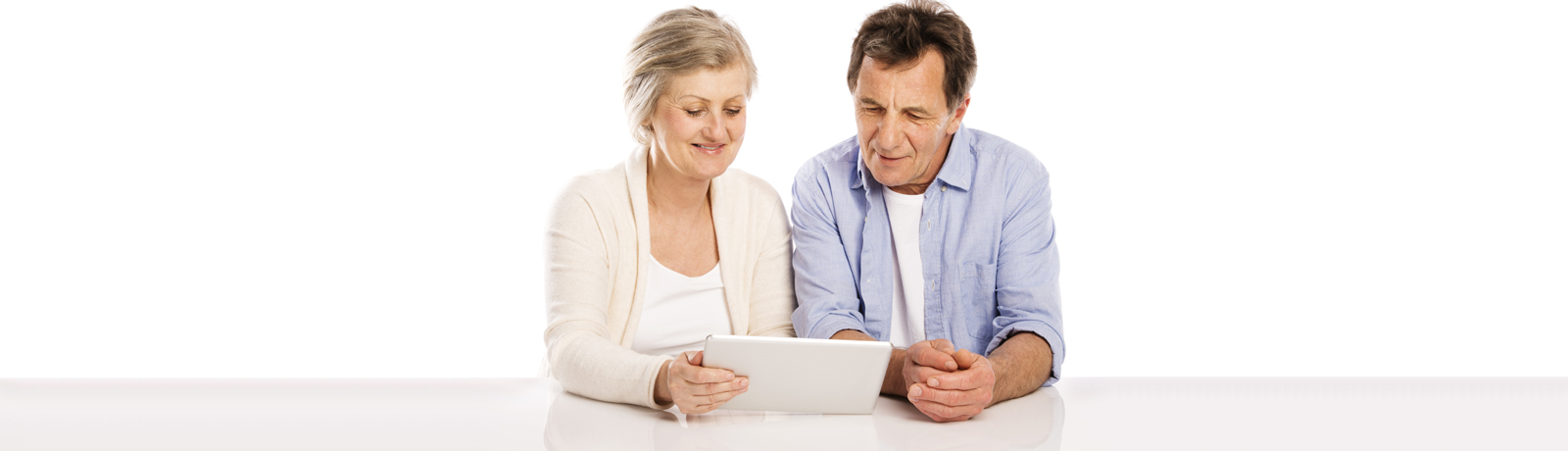 French couple looking at iPad